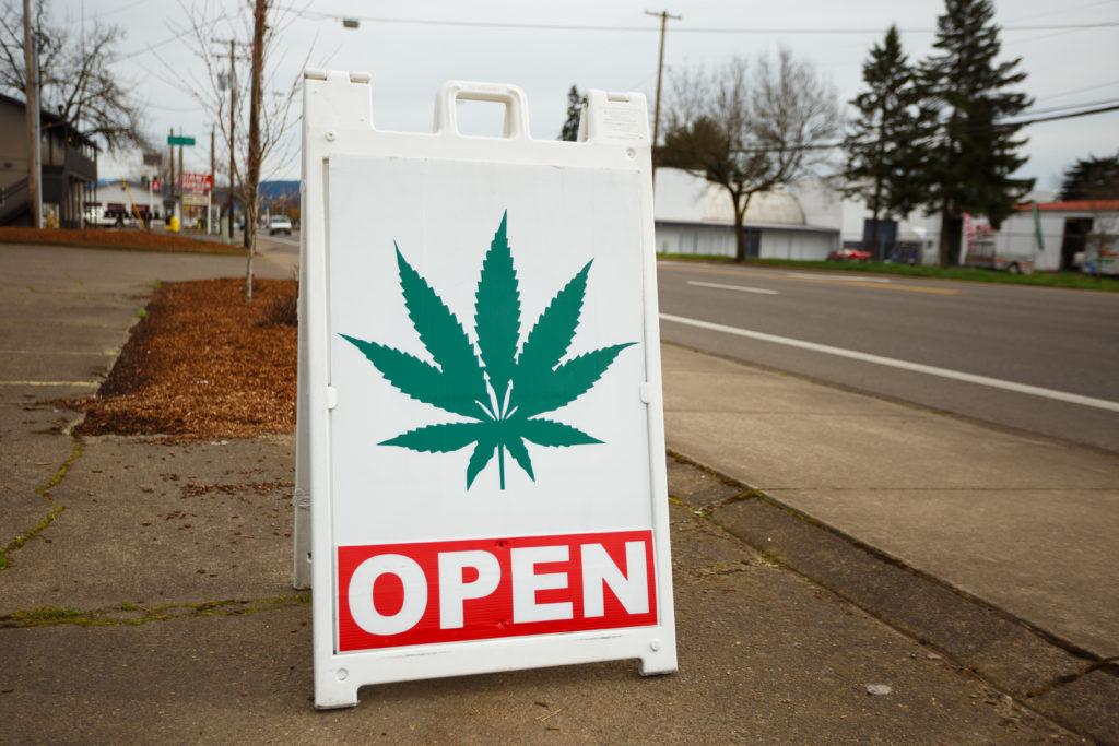 "Weed dispensary in Massachusetts; ""open"" sign"